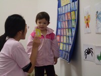Mandarin for Kids:  2 year old girl at calendar